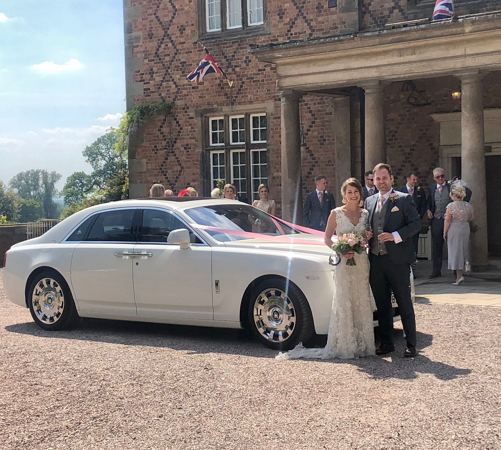 Red Carpet Cars | Wedding, Events, Airport Transfers | Couple by Rolls Royce