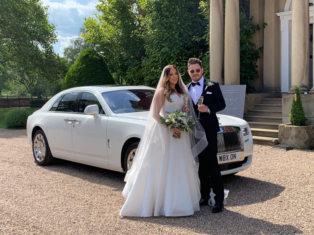 Red Carpet Cars | Luxury Wedding Cars | Couple by Rolls Royce